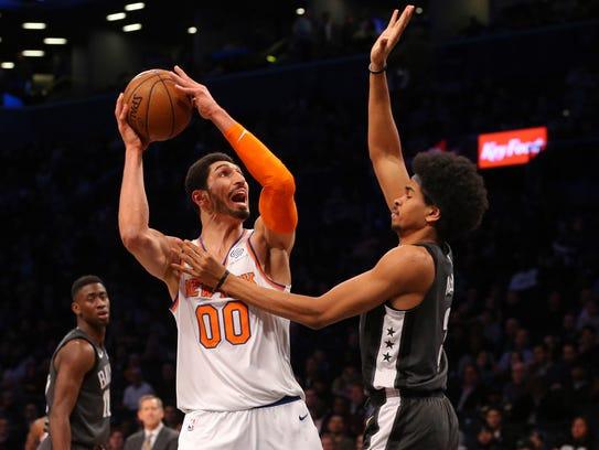New York Knicks center Enes Kanter (00) controls the