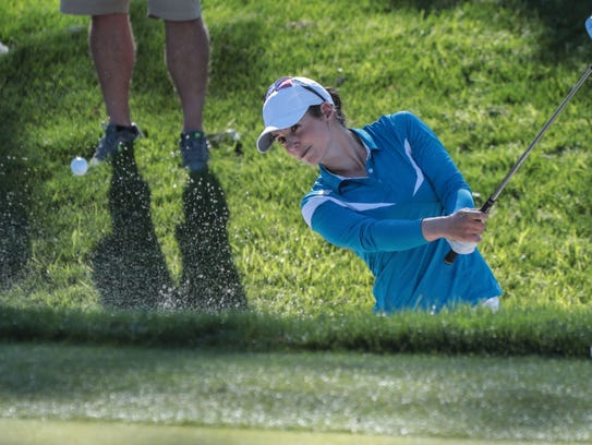 Beatriz Recari hits out of a bunker on 17 during the