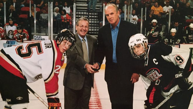 Rob Nicholson, middle right, gets set to drop the ceremonial first puck at the Resch Center during the Green Bay Green Bay Gamblers' first game at the arena in 2002.