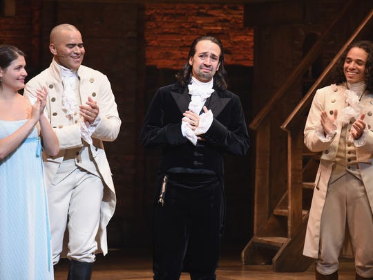 """Lin-Manuel Miranda (center) closes his final performance as Alexander Hamilton in """"Hamilton"""" as Phillipa Soo, Christopher Jackson, and Anthony Ramos applaud the musical's creator and star at the Richard Rodgers Theatre on July 9, 2016 in New York City. The performance was also the last for Soo and Leslie Odom Jr. (not pictured)."""