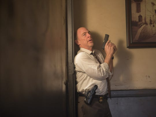 """Raymond King (J.K. Simmons), director of a Treasury Department investigative unit, is closing in on """"The Accountant."""""""