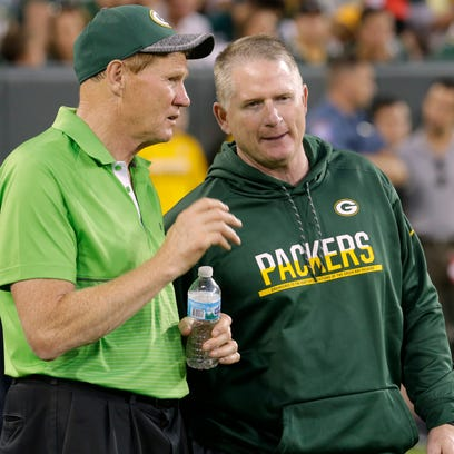 Green Bay Packers president Mark Murphy (left) talks
