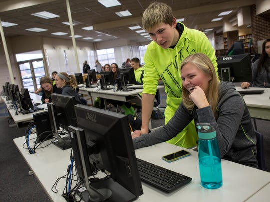 Seniors Nik Kristoff and Alyson Ervinck, both 17, work together on a computer in the media center Thursday, Jan. 28, 2016 at Algonac Junior and Senior High School. Algonac Community Schools is considering a bond campaign to address facility and technology needs in the district.