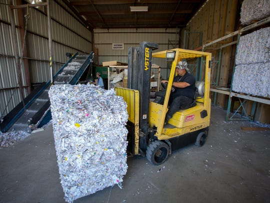 "American Document Services ""shred tech"" Joseph Rodriguez moves a bale of shredded documents on March 2, 2016. American Document Services estimates they shred over over one million pounds of documents every year."