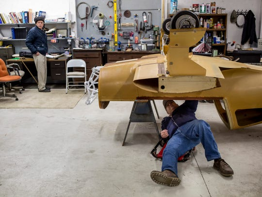 John Beattie works under a fuselage Thursday, Jan. 19, 2017 at the Experimental Aircraft Association Blue Water Chapter 979 at the St. Clair County Airport in Kimball Township.