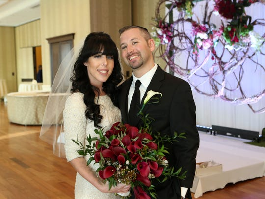 Giddy Straus, 35, and his bride, Elana Lev, 24, who