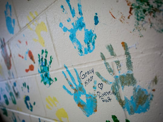 Handprints cover a wall in Andrea Heaslip's room as part of an art project between middle school students and Riverview East students Friday, June 2, 2017 at Marine City Middle School.