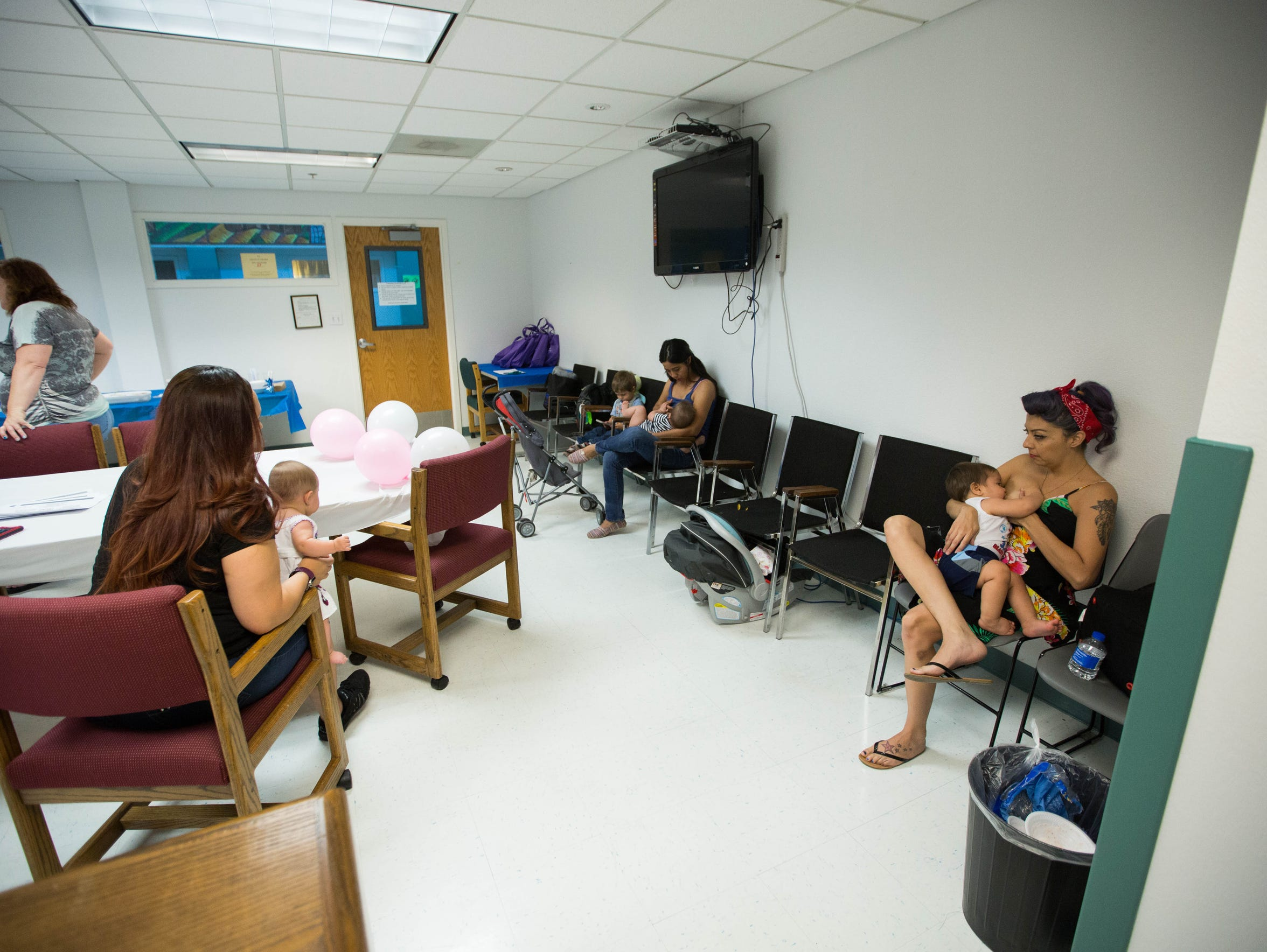 Moms and babies breast feeding at the Health Department.