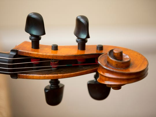 A detail of the scroll on Diana Flores' cello, made