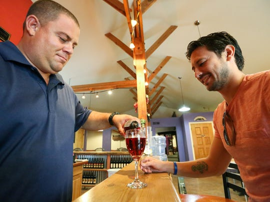Benjamin Maier, Amaro Winery owner and wine maker, pours a glass of Las Cruces Sunrise to Damien Luna, of Las Cruces, on Saturday July 15, 2017.