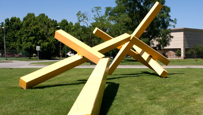 """""""Sun Target,"""" frequently nicknamed """"the French fries,"""" stands on the grounds of Springfield Art Museum in Phelps Grove Park."""