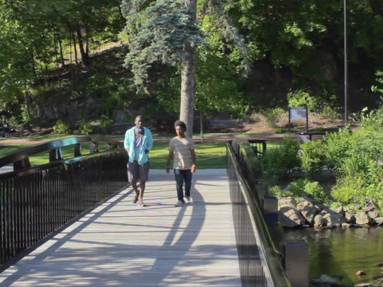 "Christopher Bird, left, and Constantine Jackson are shown in a scene from ""Poughkeepsie, Connected,"" a nine-minute film on the city's waterfront planning efforts shot by a crew of 15 city-based teenagers for Scenic Hudson through Spark Media."