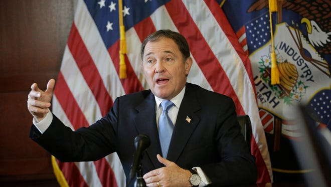 In this Thursday, Feb. 5, 2015, photo, Utah Gov. Gary Herbert speaks to reporters about his Medicaid expansion plan during a news conference at the Utah State Capitol, in Salt Lake City. Herbert is a proponent of adding work requirements for Medicaid coverage.