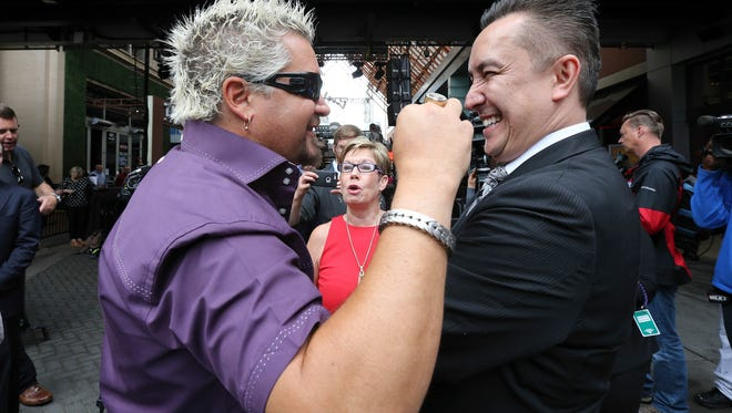 Guy Fieri jokes with a friend after a press conference announcing his new restaurant at Fourth Street Live! called Guy Fieri's Smokehouse.May 10, 2016
