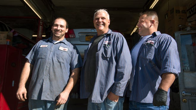 Ray's Auto owner Ray Juriga, center, with mechanics Dominic Pessagno, left, and Ron Lowe Jr.