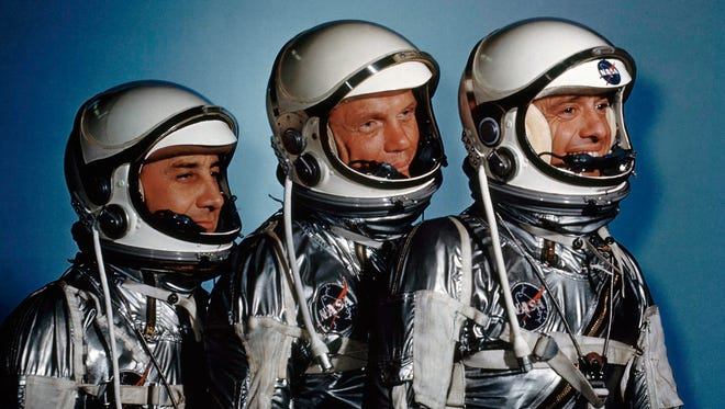 """FILE - This May 1961 file photo shows astronauts, from left, Virgil I. Grissom, John Glenn and Alan Shepard. On Friday, Nov. 11, 2016, new exhibit called """"Heroes and Legends"""" opened at the Kennedy Space Center in Florida. (AP Photo)"""