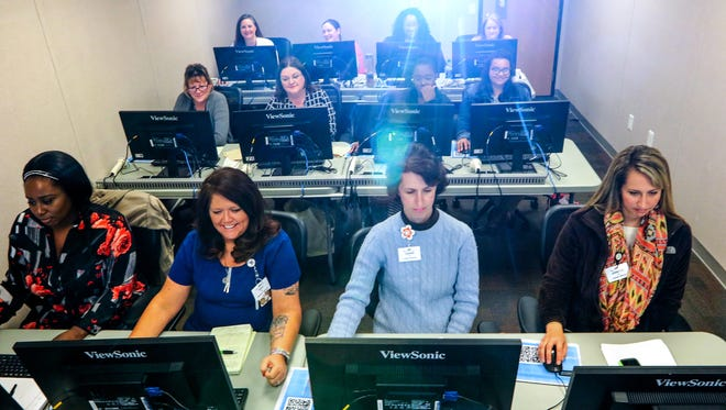 AnMed Health nurses learn new methods of filing medical information during a training class at the hospital.