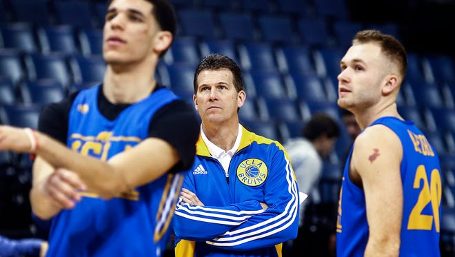 UCLA head coach Steve Alford (middle) watches his team, including Lonzo Ball (left) and Bryce Alford,  during the NCAA South Regional Sweet Sixteen practice day Thursday at FedExForum. The No. 3 seed Bruins take on No. 2 seed Kentucky on Friday.
