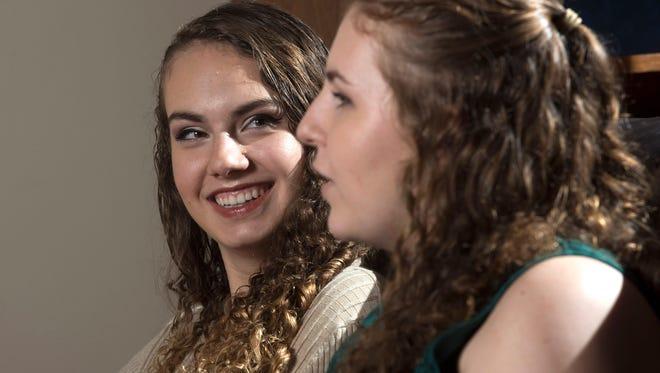 Nicole Courey, right, describes growing up in a household full of high achieving siblings Thursday, May 10, 2018.  Nicole is Milton High School's valedictorian for 2018, her sister, Sarah, left, was as the school's valedictorian in 2016, and her oldest sister finished in the school's top 5 in 2014.