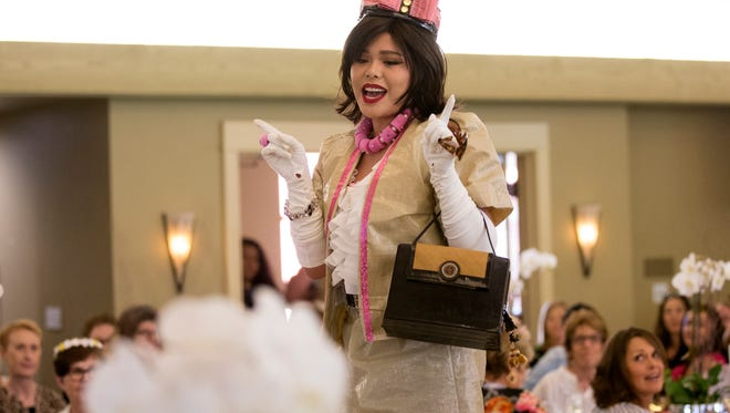 Daffney Cia dressed in a Jackie O' inspired outfit during the Alliance on Aging's 2018 Trashion Show at Corral De Tierra Country Club on Friday September 7, 2018. Her handbag was made from an old toaster.  (Photo By David Royal)