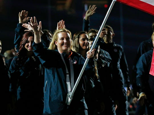 United States flag bearer Kim Rhode leads the delegation