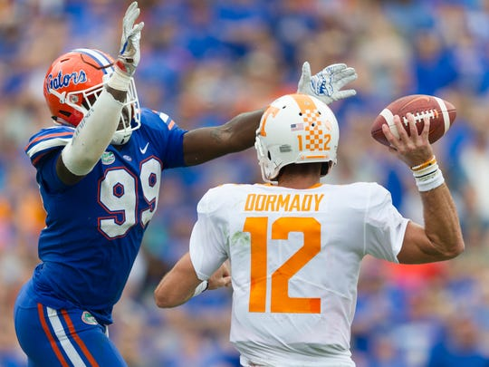 Tennessee quarterback Quinten Dormady (12) lines up a pass as Florida defensive lineman Jachai Polite (99) goes for the sack during the Tennessee Volunteers vs. Florida Gators game at Ben Hill Griffin Stadium in Gainesville, Florida on Saturday, September 16, 2017.