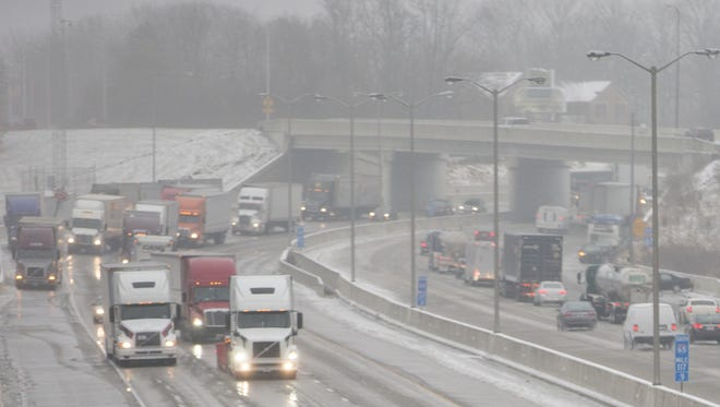 Interstate 69, where it passes 38th street, after a night of freezing rain cased myriad slip-offs and crashes, Indianapolis, Saturday, December 17, 2016. Rain is expected throughout the day, with sub-freezing temperatures overnight compounding travel conditions.