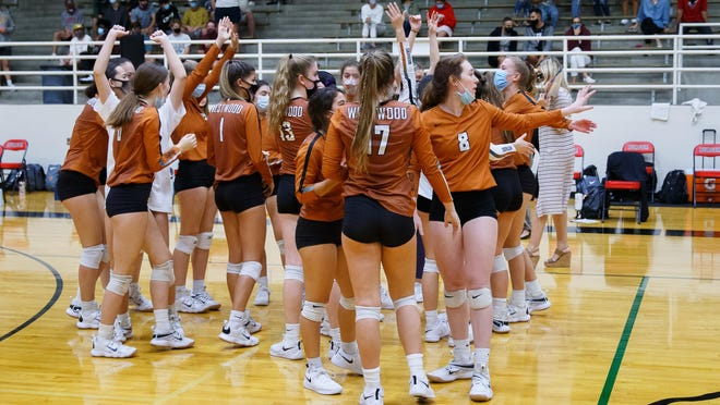 Westwood's volleyball team celebrates after a playoff win over Austin High Nov. 19 at the Toney Burger Center in Austin. The Warriors were the lone District 25-6A team to win a playoff match, and they lost in the second round.