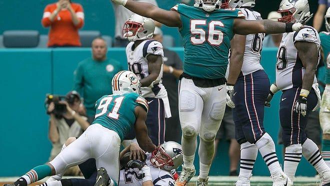 Miami Dolphins defensive tackle Davon Godchaux celebrates.