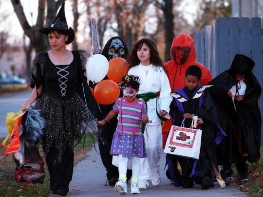 In this 1999 file photo, a sampler of scary characters are seen strolling down Seventh Street during the first few minutes of trick-or-treating. Pictured from left are Ana Ortiz, Omar Ordonez, Darian Walters, Zyanya Ordonex, Izac Ordonez, Dominic Walters and Dmitri Walters.