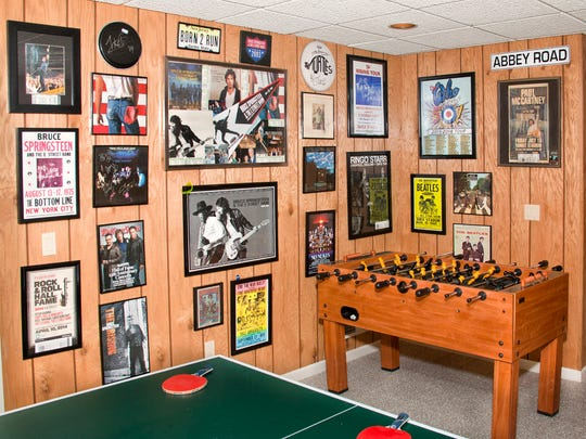 This corner of the Wynns' family room is reserved for games and music memorabilia. David is hoping to add a photo of rock 'n' roll legend Chuck Berry to the family collection soon.