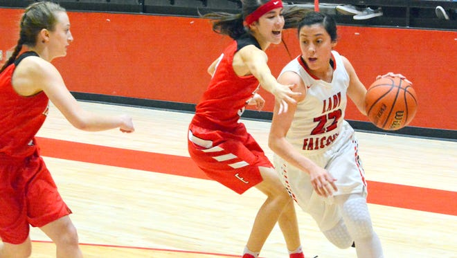 Loving's Alyssa Carrasco drives to the basket in the third quarter Tuesday.