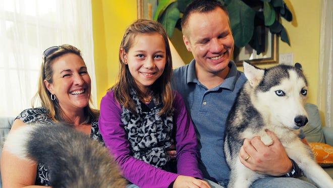 Kathleen and Magnus Bendiksen, both of Satellite Beach, with Eva, who is from Ukraine.