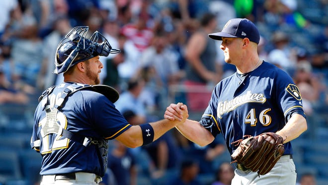 Catcher Stephen Vogt celebrates a victory with closer Corey Knebel last month.