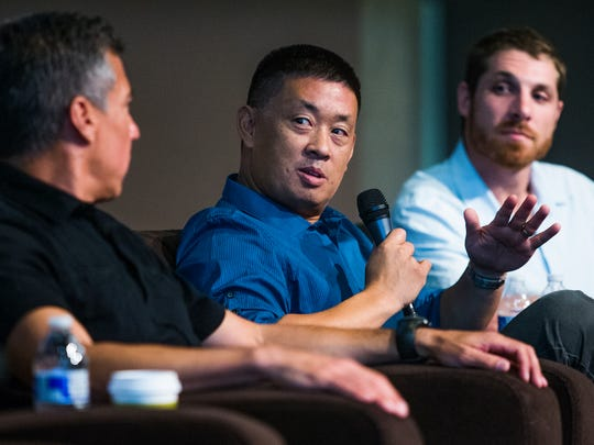 Staff members of the Arizona Republic speak the Child Immigration Crisis forum at the Walter Cronkite School at Arizona State University in downtown Phoenix, Wednesday, July 23, 2014. From left to right are; Daniel Gonzalez, Michael Chow and David Wallace.