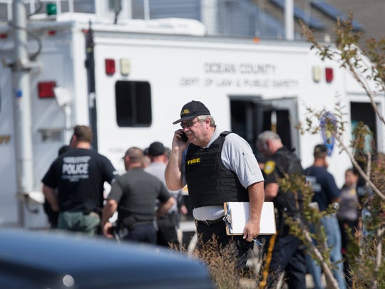 Police gather at command center in Seaside Park as