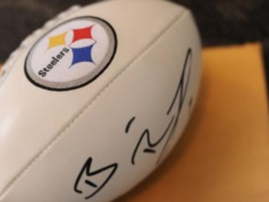 A Steelers football signed by quarterback Ben Roethlisberger was among the items that up for auction during the 2012 Martin Library Celebrity Auction. (DAILY RECORD/SUNDAY NEWS -- FILE)