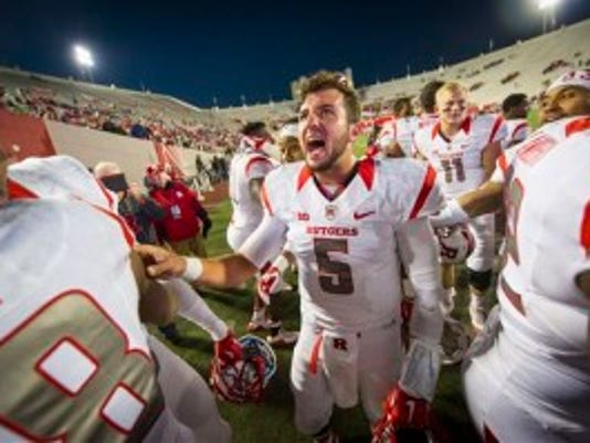 Rutgers quarterback Chris Laviano (5) celebrates with his teammates after defeating Indiana in an NCAA college football game, Saturday, Oct. 17, 2015, in Bloomington, Ind. Rutgers won 55-52 with a field goal as time expired. (AP Photo/Doug McSchooler)