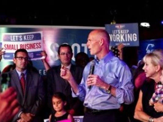 Governor Rick Scott speaks to supporters at a Republican Jewish Coalition rally to encourage early voting as part of his Get out the Early Vote bus tour at JAZZIZ Nightlife in Boca Raton on Oct. 26, 2014. (Carolina Hidalgo/Staff)