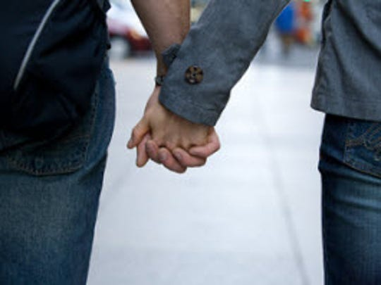 Young couple holding hands.