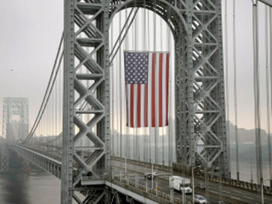 A massive flag flies over the George Washington Bridge in September 2013, a week before the lane closures that turned into scandal. (AP/Mel Evans)