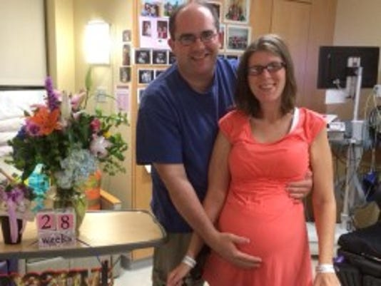 Pregnant ALS patient Amanda Bernier stands with husband Chris last week inside her room at Yale-New Haven Hospital in New Haven, Connecticut. Their daughter is due in November.