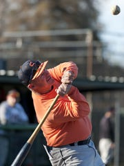 College of the Sequoias baseball coach Jody Allen hits to the outfield during practice.