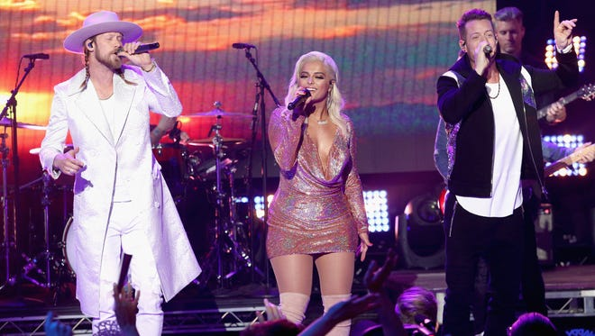 Florida Georgia Line's Brian Kelley, left, and Tyler Hubbard have a top-10 hit in 'Meant to Be' with pop singer Bebe Rexha. The collaborators performed the song during 'Dick Clark's New Year's Rockin' Eve With Ryan Seacrest 2018.'