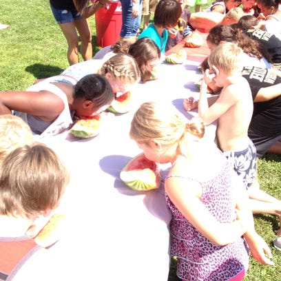 Kids compete in a watermelon eating contest at the 2014 Holt Hometown Festival. This year's event, set for Aug. 21-22, will honor World War II veterans.