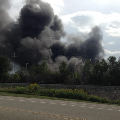 Black smoke pours from the rear of Springfield Metal Recyclers, 525 N. 24th St.