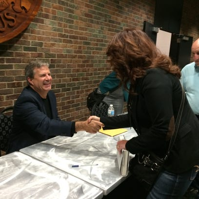 Author Sam Quinones signs books after speaking at an event in Columbus.
