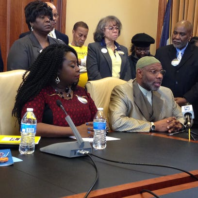 Iowa-Nebraska NAACP president Betty Andrews (left) and state Rep. Ako Abdul-Samad talk about the NAACP's legislative priorities during a news conference on Wednesday.