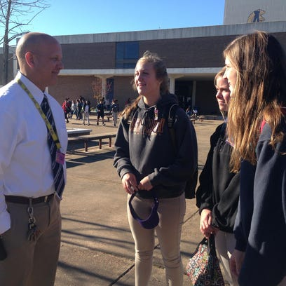 Alexandria Senior High Principal Duane Urbina talks with students after school. He said having administrators and faculty connect with students is key to their success.