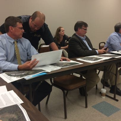 Schools officials review plans for athletic facilities at Springfield High School.